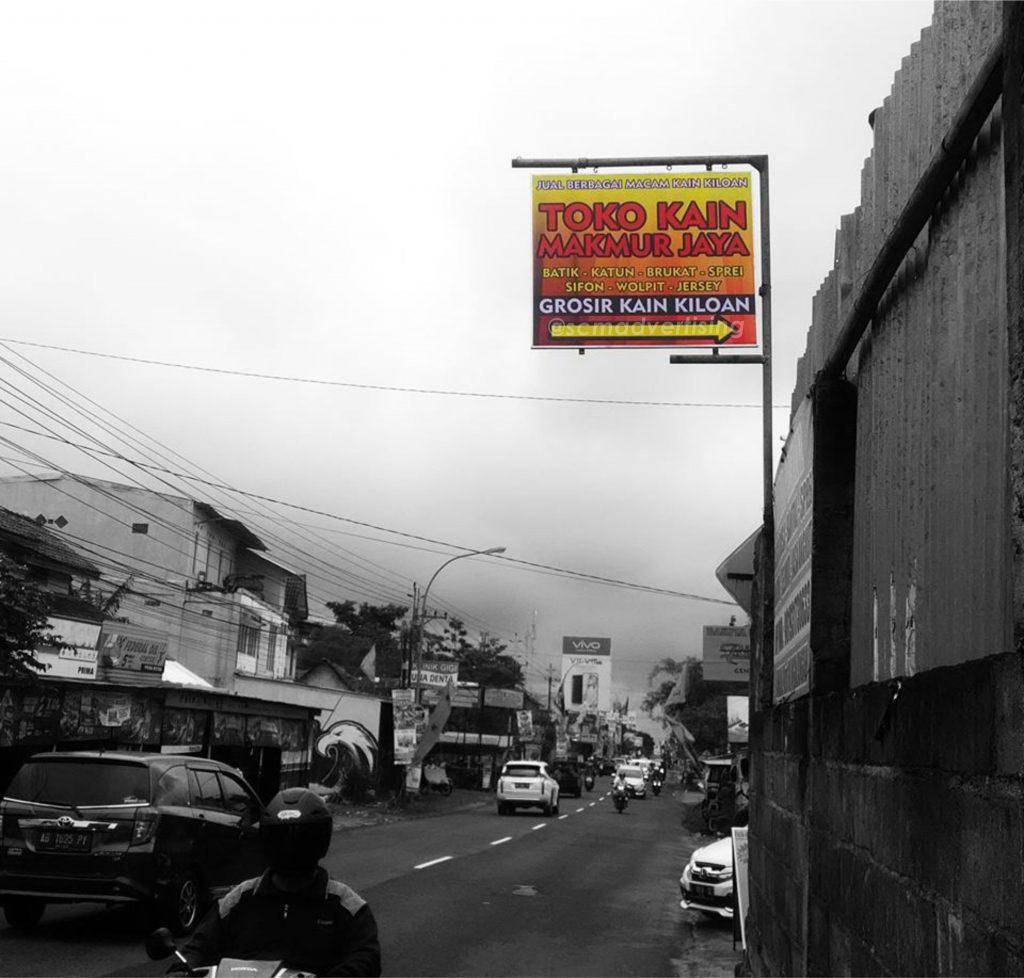 Papan Nama Toko Kain Makmur Jaya